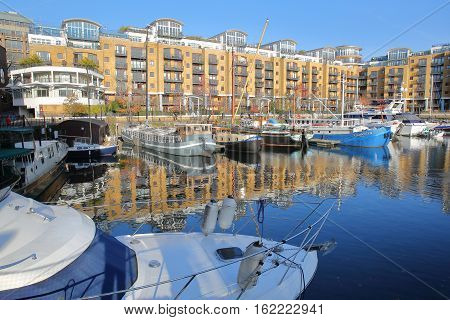 LONDON, UK - DECEMBER 11, 2016: Reflections at St Katharine docks with colorful boats