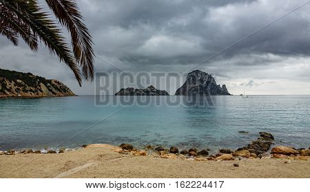 Storm over picturesque and mysterious island of Es Vedra. Ibiza, Balearic Islands. Spain