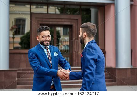 Two Businessman Handshaking Outdoors