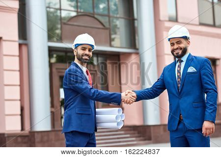 Professional Architects Shaking Hands
