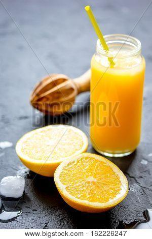 freshly squeezed orange juice on dark background close up
