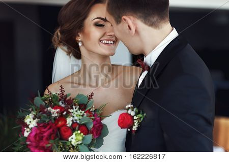 Bride Smiles While Looking At Fiance Before A Kiss