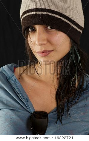 Pretty young teenager wearing beanie hat.