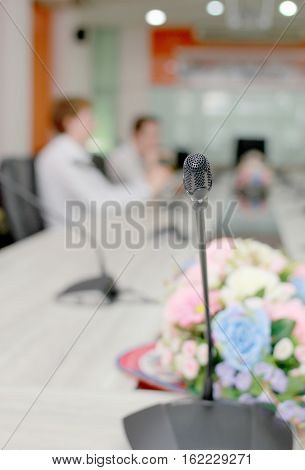 Microphone Soft Focus On Blur Abstract Background Lecture Hall/ Seminar Meeting Room In Business Eve
