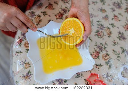 squeeze juice from orange with fork vintage table nice