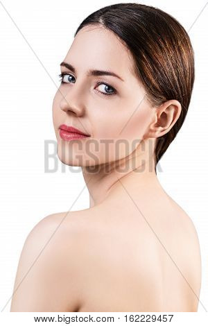 Young beautiful woman with healty fresh skin looking around isolated on white. Spa concept.