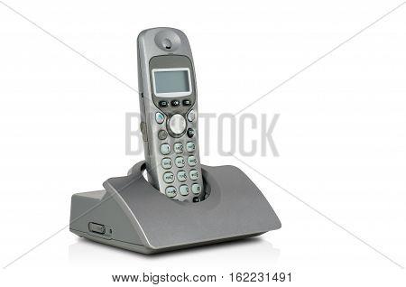 Grey cordless phone and docking station. isolated white.