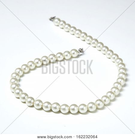 pearl necklace isolated on white white pearls