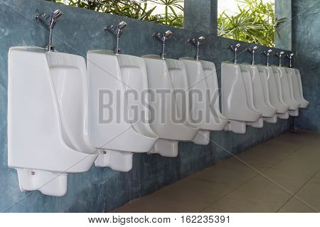 Urinals in public toilet for men only