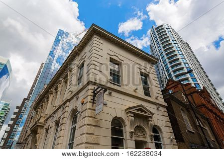 Historic Building And Skyscraper In Aldgate, London, Uk