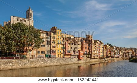 Multicolored Houses On The Waterfront In The Spanish City Of Gerona