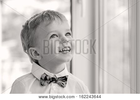 Portrait of a happy little boy with red tie ( black and white )