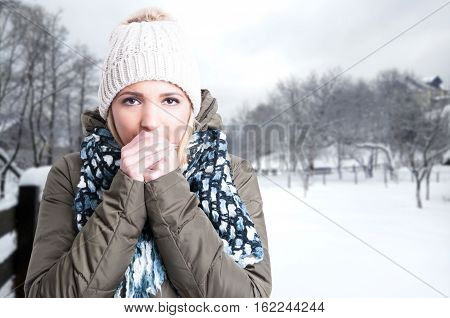 Winter Girl Blowing On Her Hands
