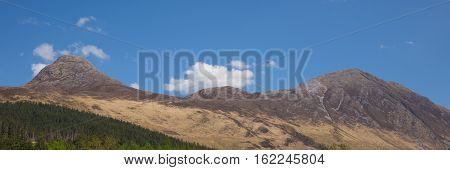 View to mountains surrounding Glencoe Village Glen Coe Scotland UK panorama