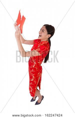 Chinese woman dress in traditional qipao and hold red envelope with money