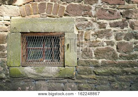 Window on the facade of a historical building