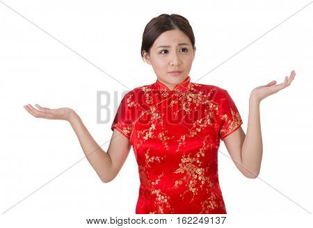 Chinese woman in traditional cheongsam in the new year with a helpless expression