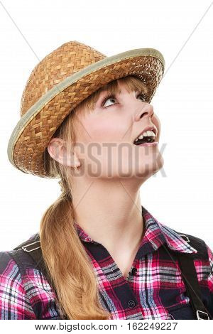 Summer clothing concept. Shocked and surprised gardener woman in sun hat looking up