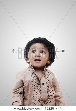 Adorable Intelligent Little Boy Arrow In Head While Standing Before A White Background; Thinking Process With Chalk Board