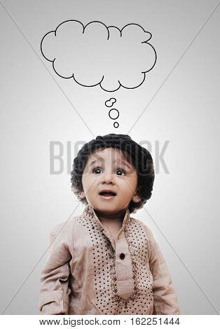 Adorable Intelligent Little Boy Thinking Cloud While Standing Before A White Background; Thinking Process With Chalk Board