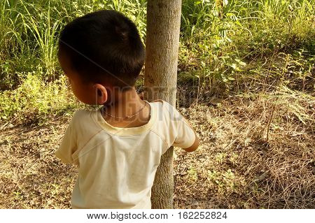 "The Boy Stood Cuddling A Tree, Model Release ""phompatipat Chompoongam"""