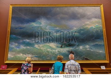 Saint Petersburg, Russia - July 26, 2014:  Visitors In Front Of The Painting
