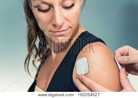 Electrodes Of Tens Device On Human Shoulder
