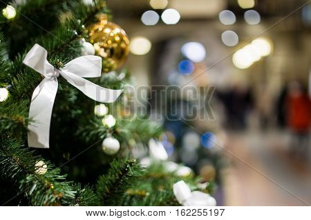 Christmas tree close-up on background of shopping center