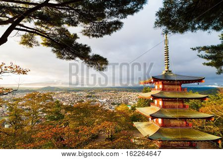 Mount Fuji and Chureito Pagoda at sunrise in colourful autumn forest. Chureito pagoda is located near Fujiyoshida train station Japan.