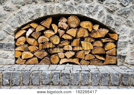 stone fireplace with firewood without fire. horizontal frame