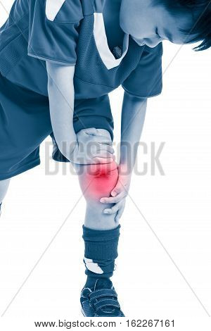 Sports injure. Youth asian soccer player in uniform injured at his knee. On white background. Color increase blue skin and red spot indicating location of pain. Studio shot.
