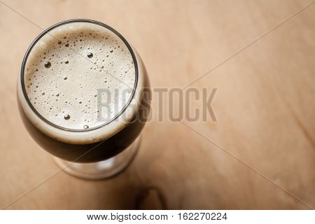 Glass Of Stout On Wood