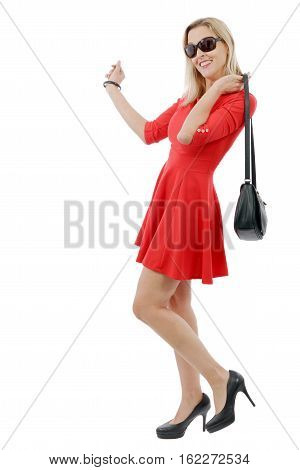 full figure of beautiful blonde woman in short red dress