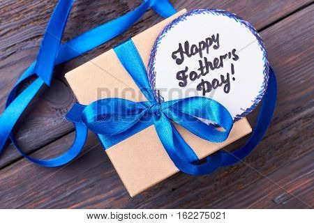 Father's Day card and gift. Greeting card and ribbon bow. Handmade greeting for dad.