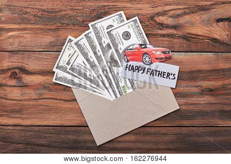 Father's Day card and dollars. Paper car on envelope. Great present for super dad.