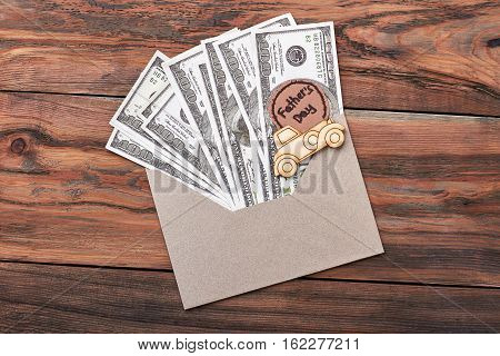 Greeting card and dollars. Envelope and pyrography car. The most useful gift.