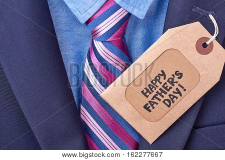 Father's Day tag and suit. Label near tie on jacket. Shopping for daddy.