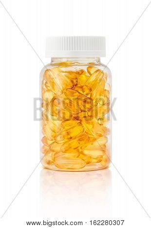 fish oil supplement capsule in clear plastic bottle with clipping path