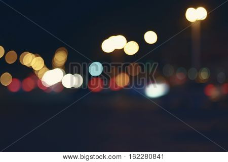 Vintage looking city nightscape with place for text, toned color image.