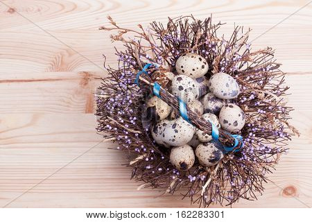 Quail eggs on the board. Copy spase. Nature background