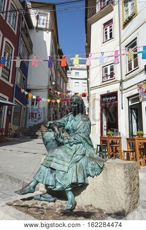 Coimbra PORTUGAL - 2016 July 19: Bronze statue of Portuguese woman in the historical center of Coimbra