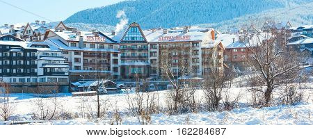 Bansko, Bulgaria - November 30, 2016: St. Ivan Rilski hotel and snow mountains panorama in bulgarian ski resort Bansko