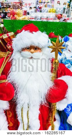 Santa Claus toy in supermarket. Christmas eve