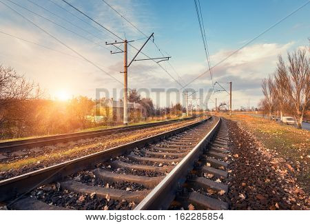 Railway Station Against Beautiful Sky At Sunset. Industrial Landscape