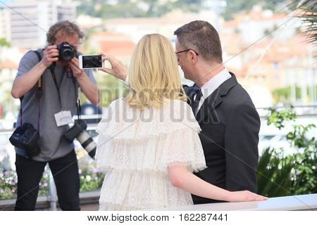 Nicolas Winding Refn, Elle Fanning attends the 'The Neon Demon' photocall during the 69th annual Cannes Film Festival at Palais des Festivals on May 20, 2016 in Cannes, France.