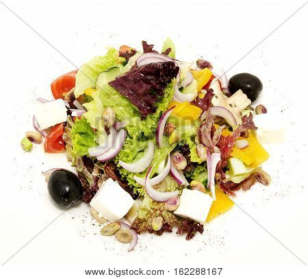 Greek salad on a table in a restaurant