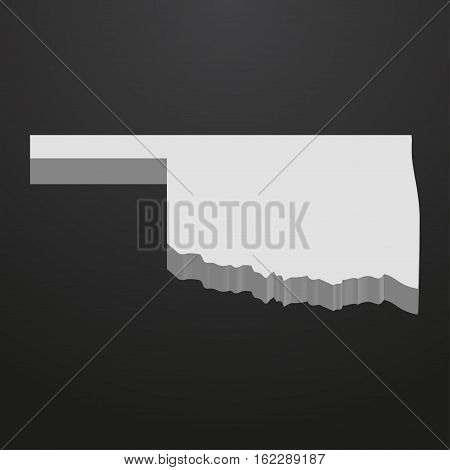 Oklahoma State map in gray on a black background 3d