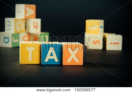 Tax Word With Colorful Blocks