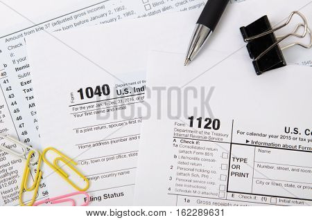 Us Tax Form 1040, 1120 On Desk