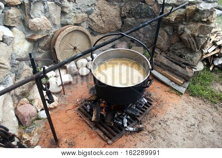 cooking in a pot on the fire